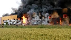 ROMANIAN FIREFIGHTER KILLED IN THE LINE OF DUTY EXTERIOR WALL COLLAPSE AT WORKING FACTORY FIRE