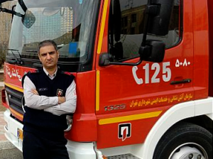 TEHRAN FIREFIGHTER DIES WHILE ATTEMPTING TO SAVE THE LIFE OF A TRAPPED FIRE VICTIM-TEHRAN, IRAN
