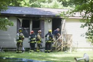 FIRE CHIEF RECALLS FALL INTO BURNING BASEMENT