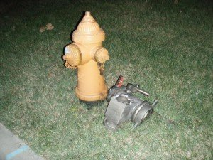 Firefighter injured when struck with flying hose