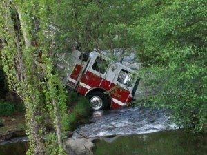 CA Engine Rolls into Creek