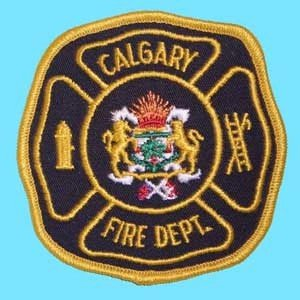 CAR RUNS RED LIGHT-STRIKES FIRE APPARATUS IN CALGARY-CIVILIAN FACING CHARGES
