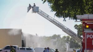 FIREFIGHTER FALLS FROM GROUND LADDER AT FLORIDA WAREHOUSE FIRE