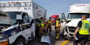 SEMI SLAMS INTO EN ROUTE AMBULANCE