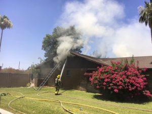 AZ FIREFIGHTER SUFFERS BURNS AT HOUSE FIRE