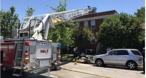 ST. LOUIS FIRE CAPT. FALLS THROUGH ROOF, SUFFERS BURNS