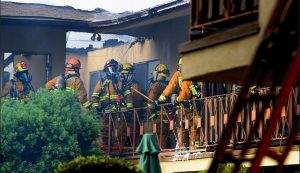FIVE CALIF. FIREFIGHTERS SUFFER HEAT ILLNESS AT APT. COMPLEX FIRE