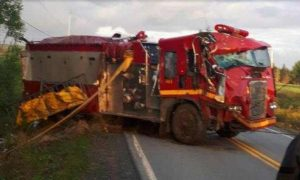 CANADIAN FIRE CHIEF ROLLS TANKER, PUMPER EN ROUTE TO FIRE