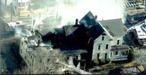 N.H. FIREFIGHTER BURNED AT HEAVILY INVOLVED FIRE