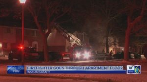 LANSING FIREFIGHTER UNIJURED AFTER FALL THROUGH FLOOR AT FIRE