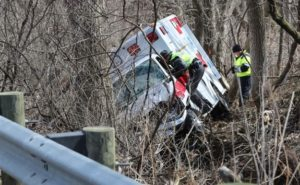 TWO MEDICS HURT, PATIENT DEAD IN AMBULANCE ROLLOVER CRASH