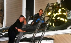 NY FIREFIGHTERS PULL 11 VICTIMS FROM FATAL HOUSE FIRE