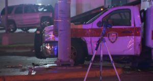 DRIVER RUNS RED LIGHT, HITS HOUSTON AMBULANCE, 5 HOSPITALIZED