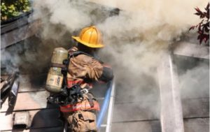 TWO FIREFIGHTERS SUFFER MINOR BURNS WHEN MO. HOUSE FLASHES
