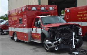 CIVILIAN TRAPPED IN CRASH WITH FLA. AMBULANCE MAKING U-TURN